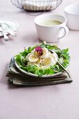 Potato salad with quail's eggs and tufted pansies