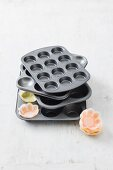A muffin tin and paper cases