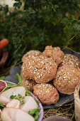 Beetroot rols with oats on an autumnal buffet in a garden