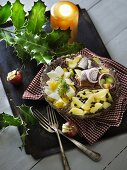 Soused herring salad with egg, potatoes and capers (Scandinavia)