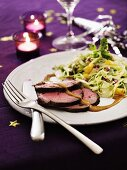 Roast beef with a fruity cabbage salad