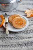 Candied orange slices half covered in white chocolate for Christmas
