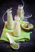 Bottles of apple, avocado and matcha smoothie in bottles