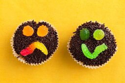 Two chocolate cupcakes decorated with jelly sweets