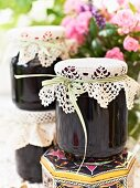 Jars of bilberry jam with lace covers