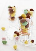 Shot glasses filled with mini chocolate eggs