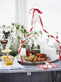 A Christmas buffet with a salmon puff pastry roulade and pork and apple tartlets