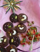 Milk and dark chocolates with nuts, candied fruits and sugar pearls
