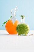 Mandarin and pistachio liqueur in decorative bottles