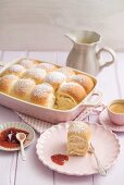 Buchteln (baked, sweet yeast dumplings) with vanilla sauce, strawberry jam and coffee
