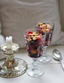 A wild berry salad with caramel sauce and crumbles
