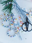 Hand-crafting glittery, sugar-bead hoops for Christmas tree