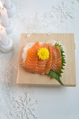 Salmon sashimi with shiso and a chrysanthemum flower (Christmas)