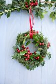Christmas wreath of holly and larch branches