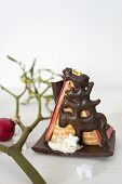 A witches house made from cake and marzipan with a chocolate model of the Bremen Town Musicians