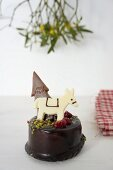 Chocolate cake decorated with a donkey and a Christmas tree