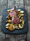 Lamb chops with roast potatoes and onions