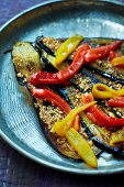 Grilled aubergine with peppers and almonds