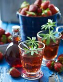 Glasses of strawberry syrup