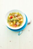 Vegetable soup with sausage meat and potatoes