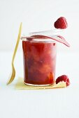 A glass of apricot and raspberry jam