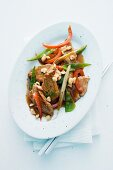 Pork fillet with vegetables and peanuts