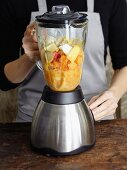 Fruit being puréed in a mixer