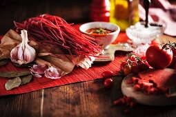 Red pasta with tomato sauce and ingredients