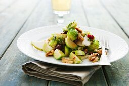 Brussels sprout salad with pear and walnuts