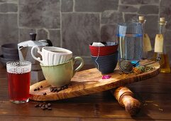 Coffee, tea, water and juice being compared on a chopping board