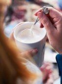 A chai latte with cream