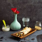 Sweet tortillas with pears and pine nuts on a wooden dish