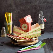 Various types of paper tableware and plastic forks