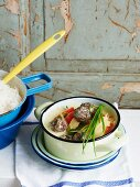 Meatballs with vegetables and coconut sauce