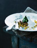 Fried foie gras with baby spinach, sweetcorn and foam