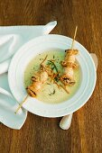 Curry foam soup with seafood skewers