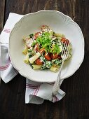 Rigatoni with spinach, ricotta, tomatoes and rocket