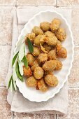 Breaded fried olives filled with anchovies