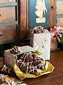 Ginger and chocolate crispy cakes in decorative gift boxes