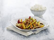 Wok fried pork strips with vegetables and plums (Thailand)