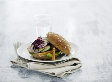 A wholemeal bun with cold roast pork and cucumbers