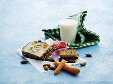 Vegetable terrine, bread, carrots, almonds, raspberries and milk for lunch