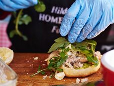 Herbs being added to a sandwich (market in Pretoria, South Africa)