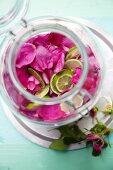 Rose petals for rosewater in a glass container (seen from above)
