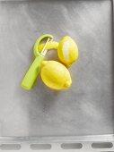 Two lemons with a peeler