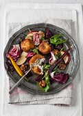 An autumnal salad with fried goat's cheese