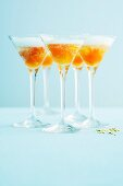 Champagne with spiced kumquats