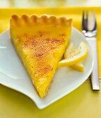 A slice of caramelised lemon tart