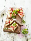 Unleavened bread pizza with chilli peppers and basil