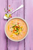 Creamy gazpacho with colourful diced vegetables and olive oil